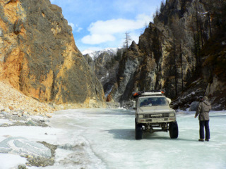 Jeep car in the ice canyons of Irkut River